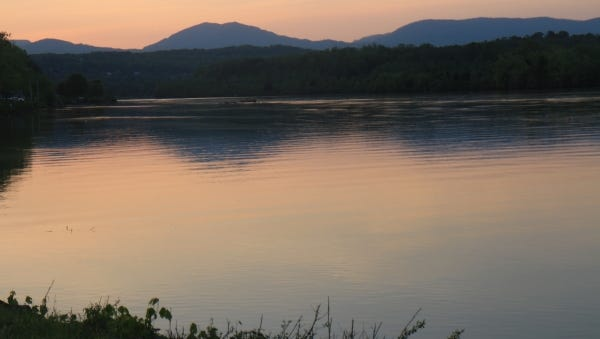 The sun sets on Melton Hill Lake below the Cumberland Mountains.