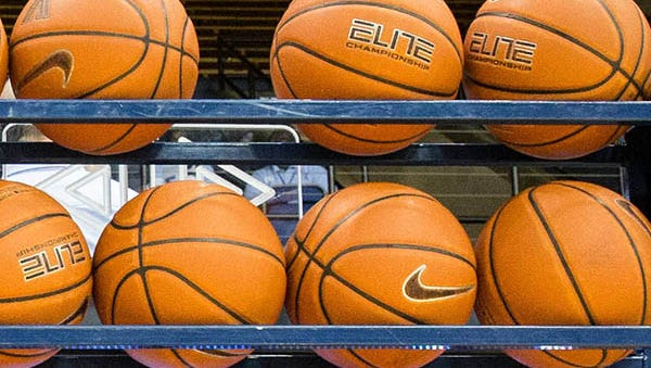 Basketballs are seen on a rack