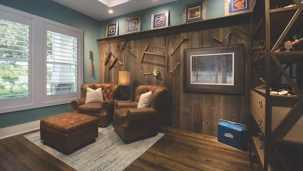 The walls of the study feature 110-year-old recycled barn wood with antique tools.