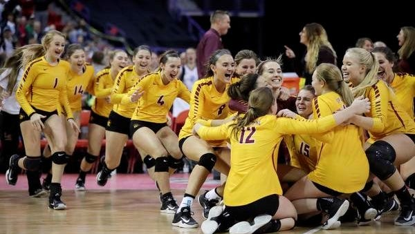 Luxemburg-Casco players rush the court after defeating Merrill 3-1 in a WIAA Division 2 state semifinal volleyball match Friday at the Resch Center in Ashwaubenon.