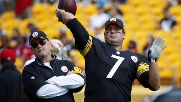 Steelers assistant coach Randy Fichtner stands next to Ben Roethlisberger as the quarterback warms up before a game against the San Francisco 49ers, Sunday, Sept. 20, 2015, in Pittsburgh. Fichtner has been picked the Steelers' news offensive coordinator. AP FILE PHOTO
