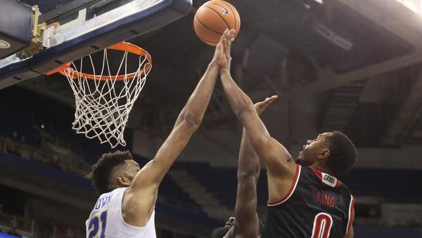 Feb 11, 2018; Pittsburgh, PA, USA;  Louisville Cardinals forward V.J. King (0) shoots against Pittsburgh Panthers forward Terrell Brown (21) during the first half at the Petersen Events Center. Mandatory Credit: Charles LeClaire-USA TODAY Sports