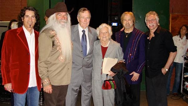 Former President George H.W. Bush and former First Lady Barbara Bush pose with the Oak Ridge Boys. Barbara Bush died on April 17, 2018 at the age of 92.