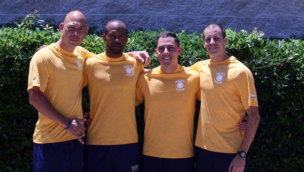 All-Navy Volleyball players Chief Petty Officer Aniahau Desha from Hilo, Hawaii, Hospitalman Gaston Yescas from Tucson, Ariz., Petty Officer 1st Class Sheldon Lucius from Pearl City, Hawaii, and Petty Officer 3rd Class Joshua Essick from York County, Pa. who saved the lives of two teenage girls at Naval Station Mayport beach, Florida.