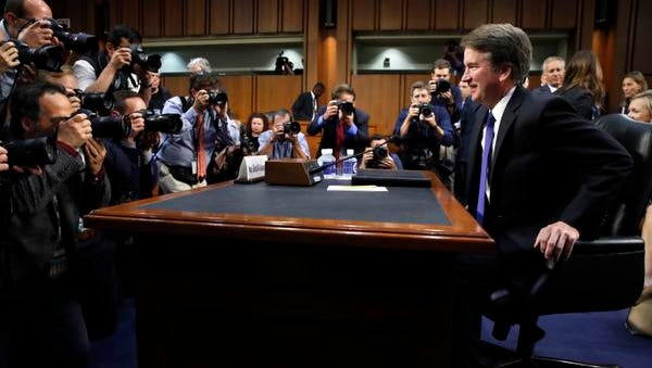 Supreme Court nominee Brett Kavanaugh, right, takes his seat after a break as the Senate Judiciary Committee returns to his confirmation hearing to replace retired Justice Anthony Kennedy, Tuesday, Sept. 4, 2018, on Capitol Hill in Washington. (AP Photo/Jacquelyn Martin)