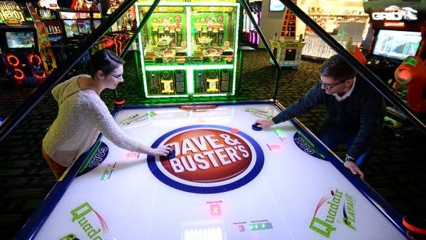 Catherine Crandall, left, and Daniel Lovelace place air hockey at the new Dave & Busters in Greenville Thursday, November 13, 2014 during a sneak peek for the media.