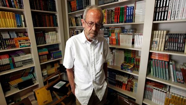 In this Sept. 17, 2012 file photo, author Elmore Leonard, 86, stands in his Bloomfield Township, Mich., home. Choice samples from a vast collection of handwritten notebooks, typed manuscripts and screenplays by the late best-selling crime novelist Elmore Leonard are going on display at the University of South Carolina. Leonard, a former adman who later in life became one of America's foremost crime writers, has died on Aug. 20, 2013 from complications from a stroke. (AP Photo/Paul Sancya)