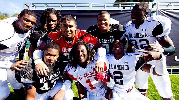 Gabe Wright (orange) and Isaiah Crowell (1) along with Alabama senior Xzavier Dickson (47) and Auburn senior Quan Bray (2) were Under Armour All-Americans.