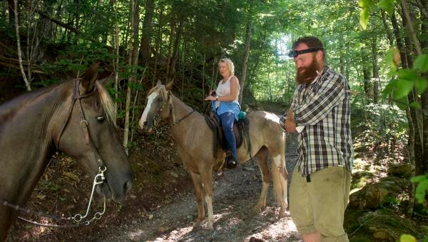 Greg White, manager of Charit Creek Lodge in the Big South Fork National River and Recreation Area, greets a group of horseback riders.