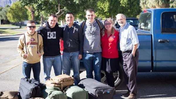 Servicemen meet at Palm Springs International Airport before being transported to Twentynine Palms Marine Base via SOS, which provides free rides from volunteers.