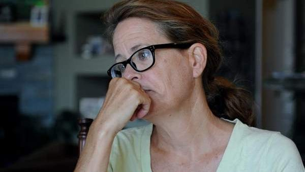 Reno resident Jill Schaller pauses while telling how her 19-year-old son, who previously had been committed to a mental health facility, purchased a gun from a Reno police officer.