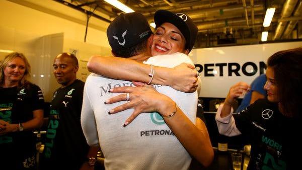 Lewis Hamilton celebrates with girlfriend Nicole Scherzinger after winning the World Championship at the Abu Dhabi Formula One Grand Prix in Abu Dhabi, United Arab Emirates.