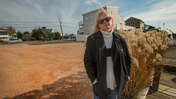 Jill Svelling Belloff in front of the empty Waretown lot where her house stood before it was destroyed by Sandy.