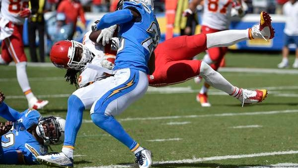 Chiefs running back Jamaal Charles is upended by Chargers cornerback Brandon Flowers while scoring a touchdown Sunday in San Diego.