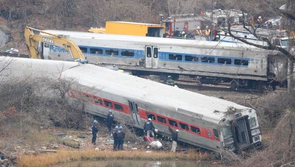 A rail crew works at the scene of the fatal Metro-North train derailment on December 2, 2013 in the Bronx near the Spuyten Duyvil station. The Metro-North passenger train derailed en route to New York City near the Spuyten Duyvil station, killing four people and wounding 63 others on December 1, 2013.