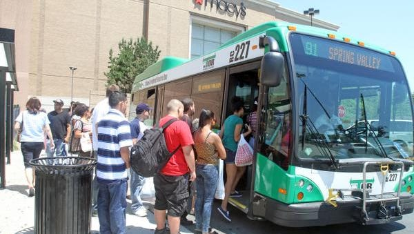 People board a Transport of Rockland (TOR) bus at the Palisades Center in West Nyack July 10, 2012.