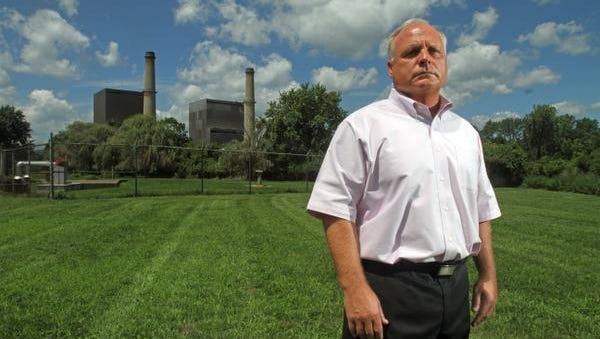 Haverstraw Town Supervisor Howard Phillips stands outside the Bowline power plant.