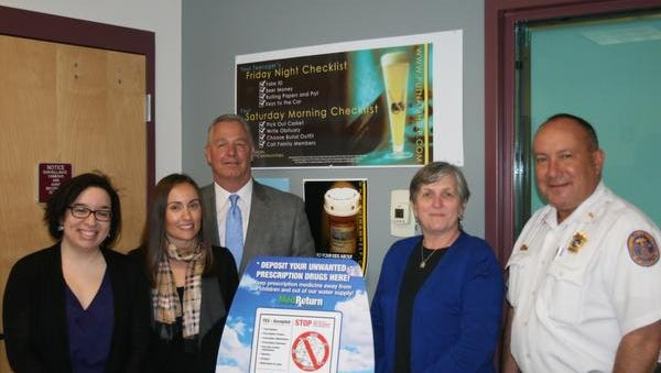 From left to right: Elaine Santos, NCADD coalition coordinator; Kristin McConnell, NCADD executive director; Joseph Demarzo, Putnam County deputy commissioner of social services; Kent Town Supervisor Maureen Fleming; and Kent Police Chief Alexander DiVernieri stand around the town's new permanent medication drop-off location at the police station, 40 Sybil's Crossing.