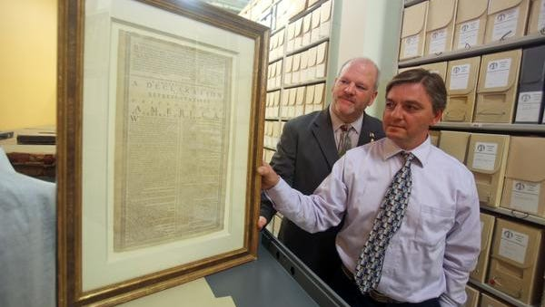 John McCaffrey, left, Chief Information Officer for Westchester County's Department of Information Technology, and Chris Gratzel, Assistant Director of the archives at the Westchester County Archive, County Records Center in Elmsford, display a copy of the Declaration of Independence April 15, 2015. The copy, known as the White Plains edition of the Declaration of Independence, was printed on July, 9, 1776, and read on the steps of the White Plains courthouse on July 11, 1776.  The historic document, along with thousands of  other items at the archive, has been digitized as part of a project to digitize historic documents.