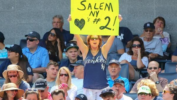 A fan displays a sign for Derek Jeter during the game against the Cincinnati Reds at Yankee Stadium on Sunday.