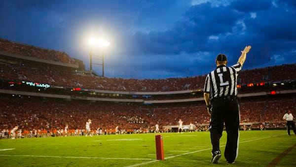 An official stands near the end zone  in Athens, Ga., as college football season kicked off across the nation Saturday.