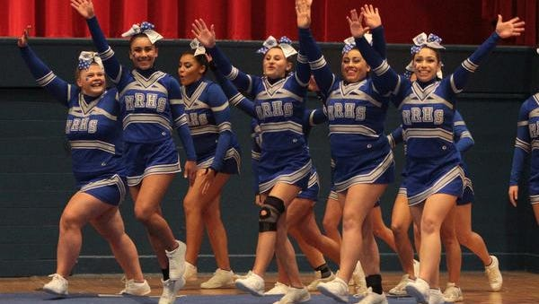 The Maria Regina team takes the floor during the 66th annual Westchester County Cheerleading Invitational at the County Center in White Plains Nov. 17, 2014.