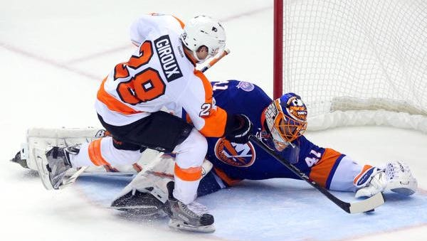 Islanders goalie Jaroslav Halak (41) makes a save on Philadelphia Flyers forward Claude Giroux during the shootout at Nassau Coliseum. The Islanders defeated the Flyers 1-0.