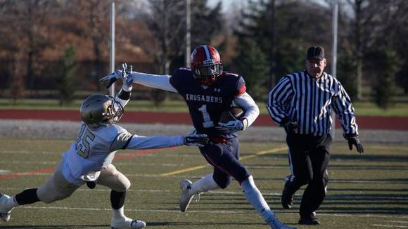Stepinac's Gavin Heslop (1)  rushes against Canisius in the second quarter of the Catholic state championship at Mitchel Field in Uniondale on Dec. 7, 2014.  Canisius won 23-10.