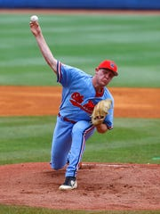 Mississippi pitcher Houston Roth throws during the