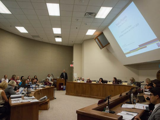 The New Mexico State University Board of Regents listen