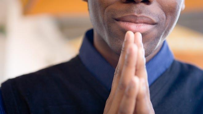 A man prays.