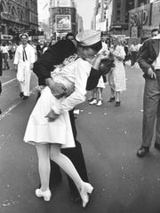A jubilant American sailor clutching a white-uniformed nurse in a back-bending, passionate kiss as he vents his joy while thousands jam Times Square to celebrate the long awaited-victory over Japan. The Museum of Military Memorabilia will commemorate the 70th anniversary of V-J Day on Aug. 15.