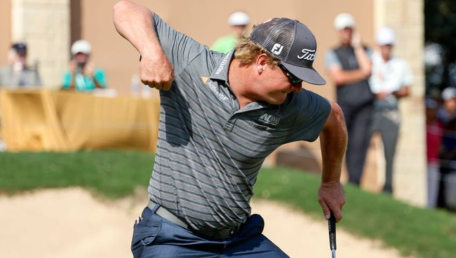 Apr 24, 2016; San Antonio, TX, USA; Charley Hoffman celebrates after sinking a birdie putt at 18 to win the Valero Texas Open during the final round of the 2016 Valero Texas Open at TPC San Antonio - AT&T Oaks Course.