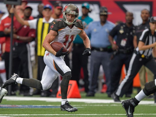 Tampa Bay Buccaneers wide receiver Adam Humphries (11) carries the ball against the Atlanta Falcons on Sunday, September 11.