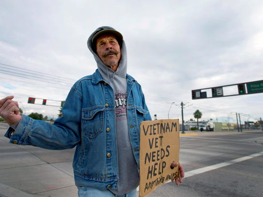 Stephen Quick, 60, panhandles on the corner of Apache