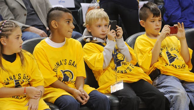 Young fans take photos of their favorite Pacers during FanJam 2012 at Bankers Life Fieldhouse.