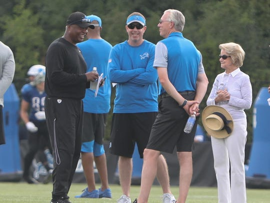 From left, coach Jim Caldwell chats with GM Bob Quinn,
