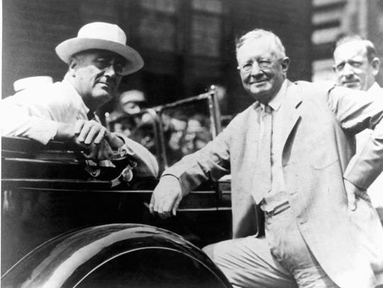 George F. Johnson (right) whose Square Deal policy