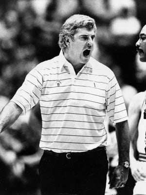 Indiana University basketball coach Bob Knight screams at a referee after he is ejected for three technical fouls, including a chair-throwing incident, in the Big Ten Conference Tournament game against Purdue University in Bloomington, Ind., Feb. 23, 1985.