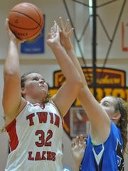 Taylor Burns drives to the rim for the Indians in Thursday's