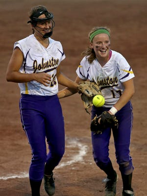 Johnston pitcher Haylee Towers, left, wore a face mask while helping her team to a state title in July..