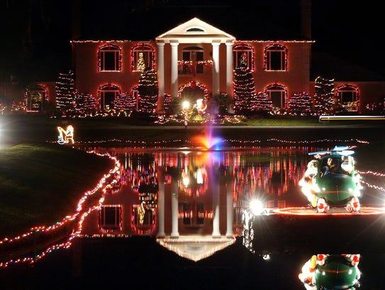 The lights at Tara Plantation shine for visitors driving