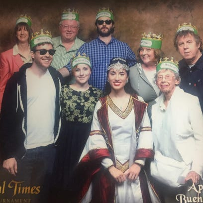 Bruce Fessier and his family (and one straggler) pose with Princess Catalina as part of the Green Team at Medieval Times in Buena Park. The amusement park is offering special two-for-one tickets to Desert Sun readers