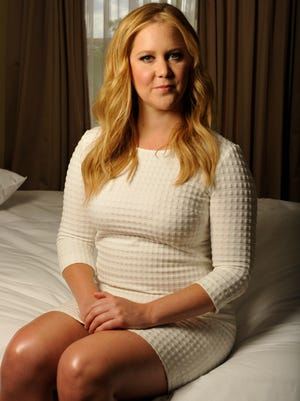 Amy Schumer will co-host a Bud Lite party in an ad airing during the Super Bowl on Feb. 7. It's among several commercials going for viewers' funny bones.