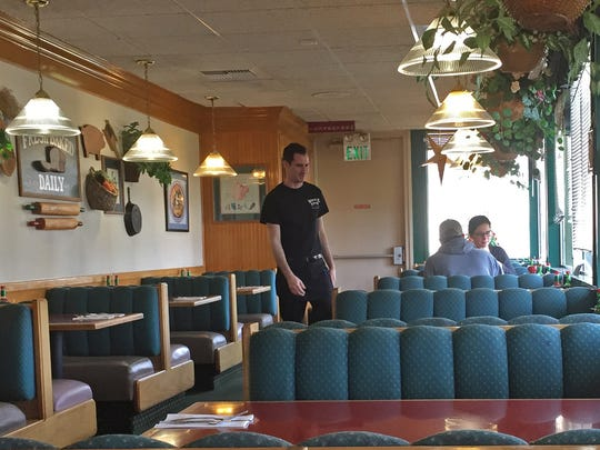 Ferris checks with diners to see if they need anything at the Waffle Shop, Salinas