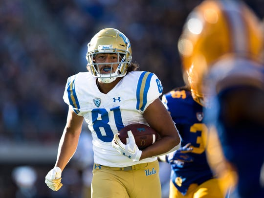Oct 13, 2018; Berkeley, CA, USA; UCLA Bruins tight end Caleb Wilson (81) runs the ball against the California Golden Bears in the second quarter at California Memorial Stadium. Mandatory Credit: John Hefti-USA TODAY Sports