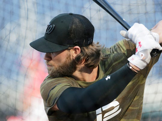 Washington Nationals' Bryce Harper takes batting practice prior to a baseball game against the Los Angeles Dodgers, Sunday, Sept. 17, 2017, in Washington. (AP Photo/Mark Tenally)