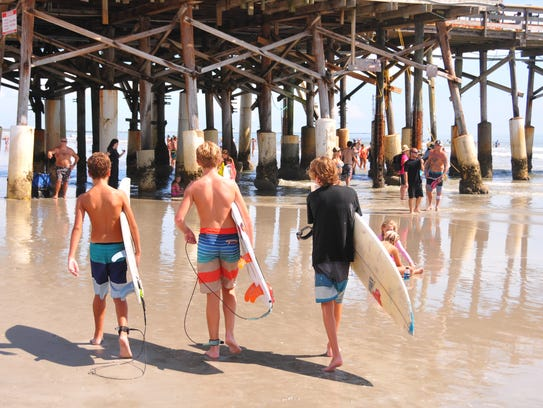 Big crowds and small waves showed up for the 32nd annual