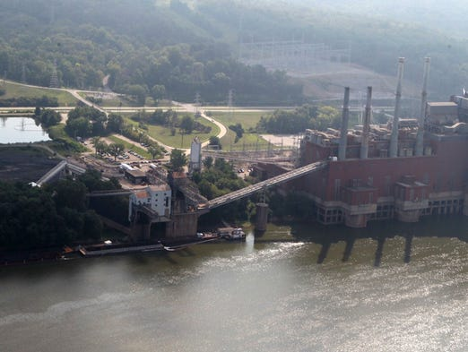 A thin band of diesel fuel flows down the Ohio River  from Duke Energy's Beckjord station near New Richmond where about 5,000 gallons of diesel fuel were spilled during a transfer at the station.