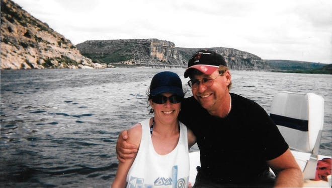 Cindy Davis and her husband, Mike Davis, out on a boat. Fishing was one of their favorite activities